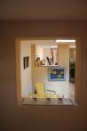 Vy mot kök och hall från trappan upp till andra våningen